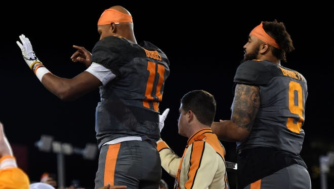 Tennessee Volunteers quarterback Joshua Dobbs (11) and defensive end Derek Barnett (9) direct the band at the end of the Franklin American Mortgage Music City Bowl at Nissan Stadium in Nashville, Tenn., Friday, Dec. 30, 2016. Tennessee won 38-24.