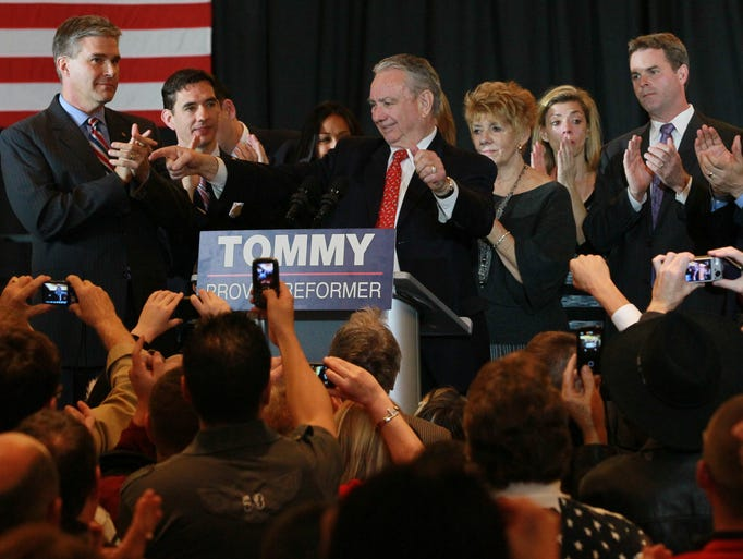 Tommy Thompson, surrounded by Gov. Walker, J.B. Van