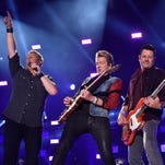Gary LeVox, Joe Don Rooney, and Jay DeMarcus of Rascal Flatts perform onstage at the 2014 CMA Festival on June 5, 2014 in Nashville, Tennessee.
