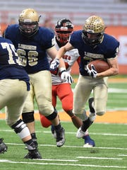 Lourdes' Joe Scaglione runs the ball during the New York State Championship final versus South Park in Syracuse on Friday. Lourdes lost to South Park 49-46.