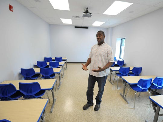 Pastor Will Grimes from Solid Rock Baptist Church shows a classroom at the church's new community center on North West Street in Dover.