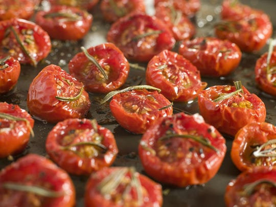 Oven drying plum tomatoes locks in the vegetable's sweet flavor. The tomatoes will keep in the refrigerator for at least a month.
