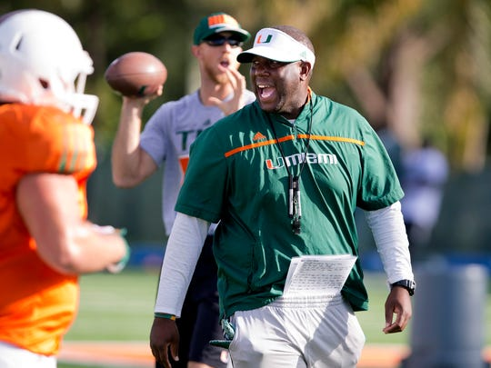 Miami interim head coach Larry Scott leads an NCAA college football practice on Oct. 27, 2015, in Coral Gables, Fla.