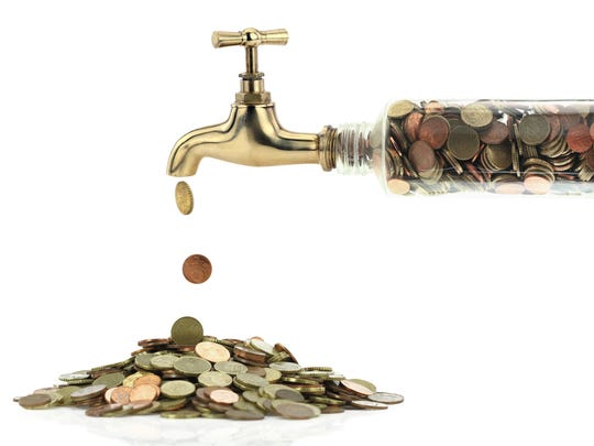 Faucet full of coins with money dripping out.