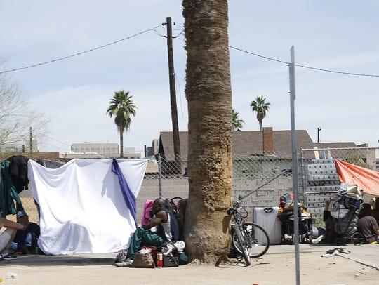 Homeless place encampments on the sidewalks near the