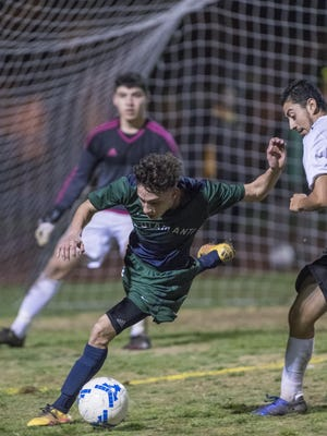 El Diamante's Andrew Garcia pressures the Golden West defense near the goal before drawing a penalty kick that sealed the 2-0 win in a West Yosemite League boys soccer game Wednesday, February 8, 2017.