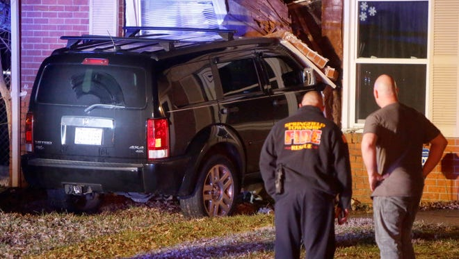 A car crashed into a Springfield Township home Tuesday night sending a teenager, who was inside the home, to the hospital.