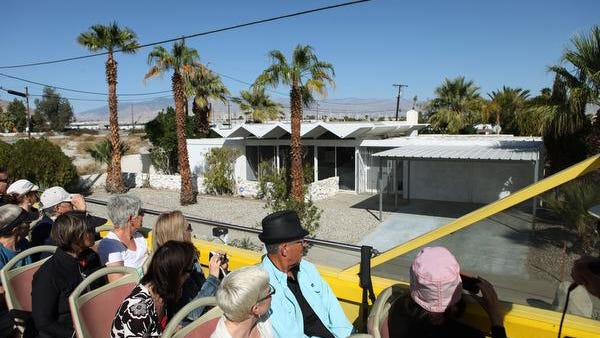 Architecture enthusiasts take part in the bus tour of mid-century modern architecture during Modernism Week last year in Palm Springs.