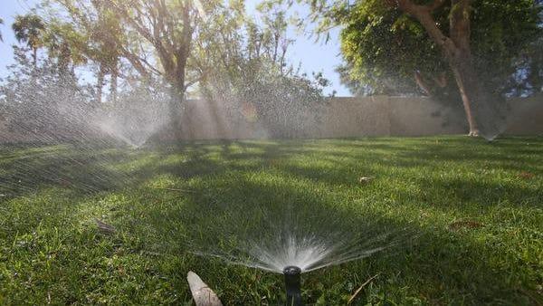 Sprinklers water a lawn in Bermuda Dunes.