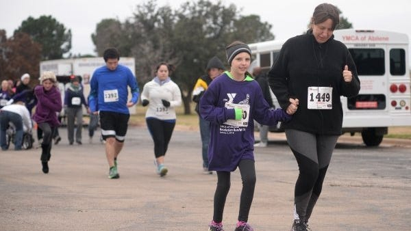 Joy Bonala/Special to the Reporter-News   Runners participate in the YMCA Resolution Run on Saturday, Jan. 2, 2016, at Redbud Park.