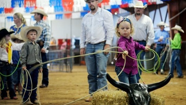 Young Macy Compton takes first place in her age category in the dummy roping competition at the 2016 Western Heritage Classic at the Taylor County Expo Center.