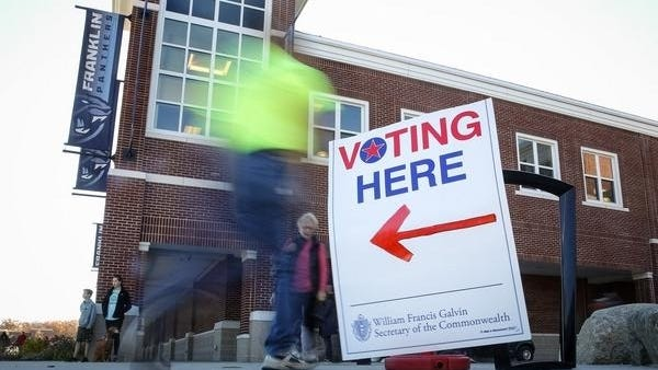Voters come and go at Franklin High School during the November 2016 election.
