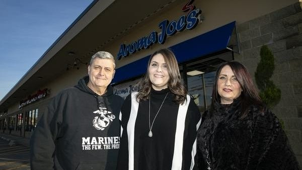 Aroma Joe's family owners Joseph Fernandes, daughter Brittany Fernandes and Rose Fernandes pose for a portrait outside their newest location at 325 New State Highway in Raynham on Monday, Oct. 19, 2020.