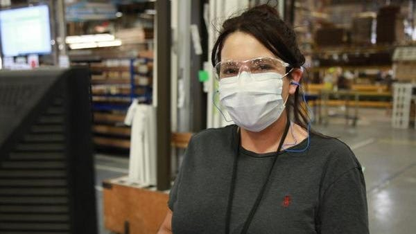 An employee at Haworth, headquartered in Holland, poses for a photo in a mask in early 2020. Haworth, one of the region's largest manufacturing employers, has required employees to wear masks per state regulations for months.