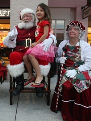Scenes from the Santa Claus Society's 3rd annual fundraiser Friday at the Bell Tower Shops in Fort Myers. The event featured performances by the Heights Elementary School choir, Kellyn Celtic Irish dancers, pictures with Santa, holiday crafts and a raffle. The society provides Christmas for families and children in Southwest Florida who may otherwise not be able to share in the joy of the holiday season. Go to santaclaussociety.com to donate and learn more.