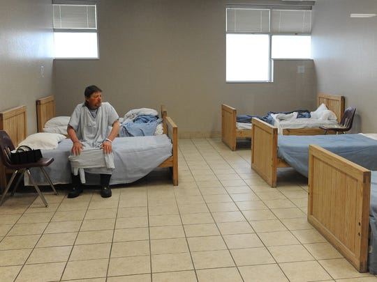 A 2012 file photo of  WestCare Community Triage Center patient Jerald, who just gave his first name, sitting on his bed in the men dormitory at the center.