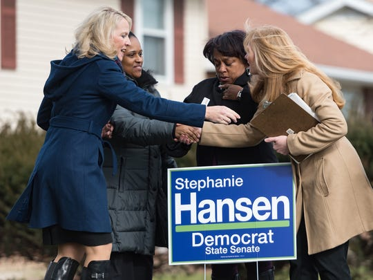 Lt. Gov. Bethany Hall-Long (left) and Democratic Senate candidate Stephanie Hansen (right) speak with Bronte Garnett and Everetta Jefferson in Middletown as they canvass voters for the special election in the Middletown area.