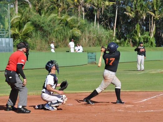 Mateo Escalona at bat in a friendship game against