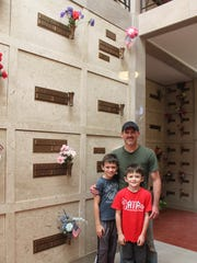 Jeremy Welborn and his sons Sam, 9, and Parker, 7, admire the vault of former Oregon Governor Charles Sprague.