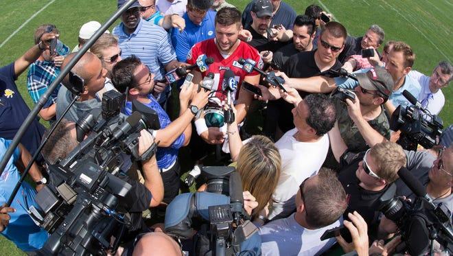 Philadelphia Eagles quarterback Tim Tebow (11) talks to the media during OTA's at the NovaCare Complex.
