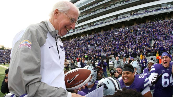 Kansas State head coach Bill Snyder is carried off the field by his players following a game last season. Nevada will play at Kansas State in 2021.