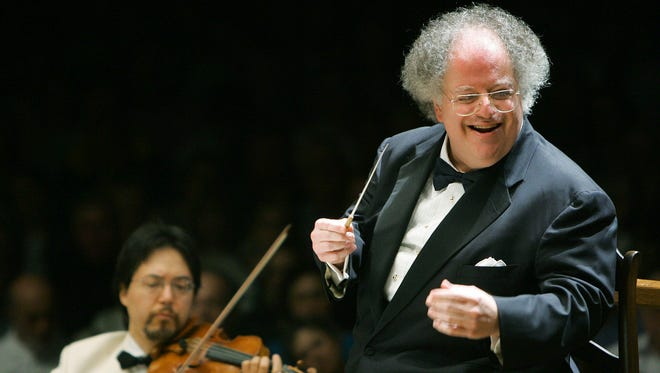 This photo taken July 7, 2006 shows Boston Symphony Orchestra music director James Levine, right, conducting the symphony on its opening night performance at Tanglewood in Lenox., Mass. This was Levine's first appearance since injuring his shoulder in an onstage fall in March 2006. (AP Photo/Michael Dwyer)