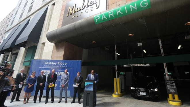 Former Bengals player Chinedum Ndukwe spoke at this fall's grand opening for the Mabley Place garage on Fourth Street in the old Tower Place Mall. Ndukwe's real estate firm, Kingsley Wells Enterprises, worked on the project.