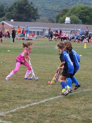 At area youth field hockey tournaments, kids are split into three age groups (grades K-2, 3-4 and 5-6), and each team plays 20-minute games.