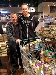 Craft Services Chef Ismael Aguilar and Chris Koyle were spotted out shopping at Fresh Market for Melissa Etheridge's meals to be served before and after her performance at the Ford Center.