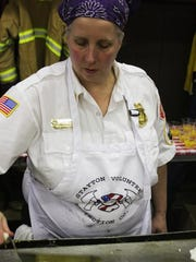 Capt. Sherry Bensema gives the eggs a little TLC at the Mehama Fire Station Sweetheart Benefit Breakfast