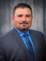 Eddie Martinez was sworn in as board chairman of the