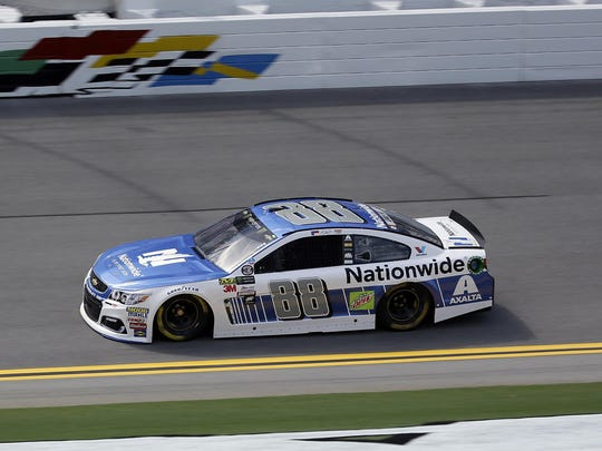 Dale Earnhardt Jr. (88) completes a lap during a NASCAR cup auto racing practice at Daytona International Speedway on Thursday.