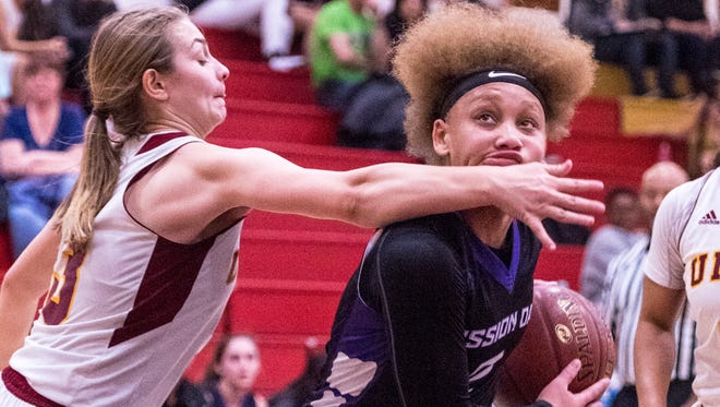 Tulare Union's Madisyn Melson, left, pressures the shot of Mission Oak's Kambrayia Elzy in an East Yosemite League high school girls basketball game on Wednesday, January 24, 2018.
