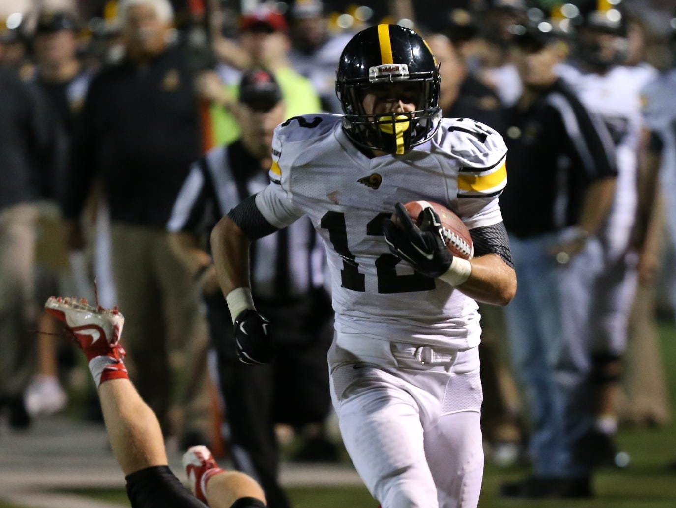 Southeast Polk running back Cole Hauser escapes a diving effort from Des Moines East's Rory Walling on the way to a touchdown Friday at Williams Stadium. Hauser rushed for 159 yards and had four total touchdowns in a 56-7 victory.