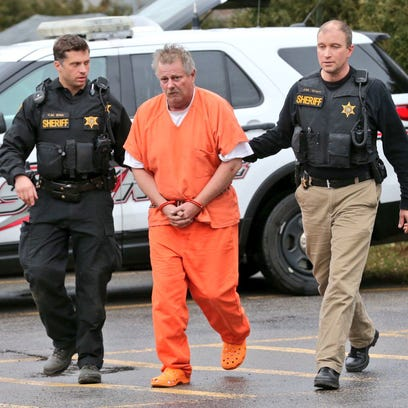Kyle Johnson walks into Le Roy Town Court on Tuesday