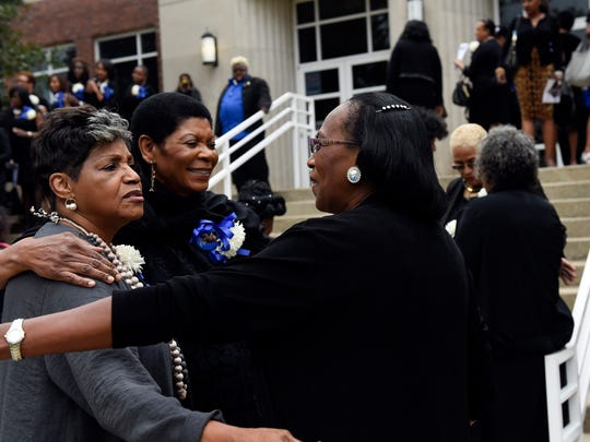 Former Tigerbelles Charlene Rudolf, Una Morris and Madeline Manning Mims hug each other following a funeral service for Coach Ed Temple at TSU's Kean Hall Gymnasium Friday, Sept. 30, 2016, in Nashville, Tenn.