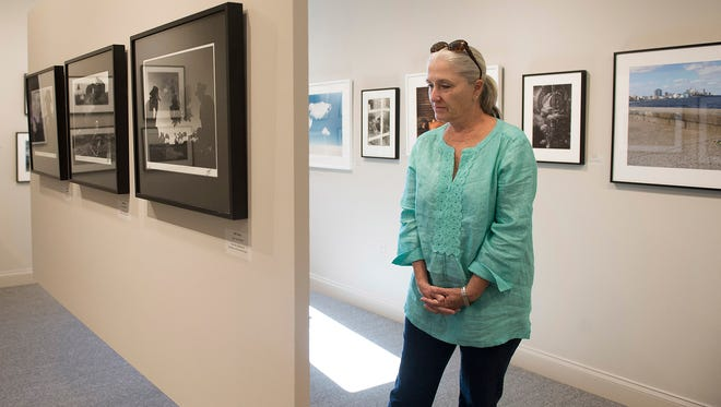 """The A.E. Backus Museum and Gallery had a Cuban-themed reopening celebration Nov. 20, 2016, in Fort Pierce. The gallery has been closed for five months for a $1.4 million renovation and expansion project that added 2,500 square feet to the building. Local artist Mary Lindemann-Allers, of Hutchinson Island, Fort Pierce, looks through the photography and sculpture exhibit, """"Cuba. It's Not All Black and White,"""" by artists Madeleine and Harvey Plonsker.""""I love the new addition to the Backus,"""" said Lindemann-Allers adding, """"It's just wonderful."""""""