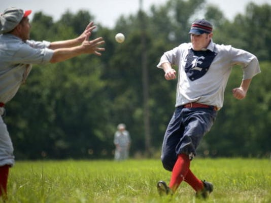 """Jon """"Hammer"""" Hepner of the Neshanocks reaches for the ball as Elkton player Glyn """"Hammer"""" Richards tries to make it to third during the July 2010 festival."""