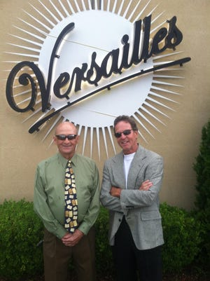 """Owner R.K. """"Skip"""" Hunter and manager Randy Delaney pose in front of Versailles — The Event Center."""