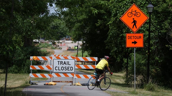 A bicyclist has to detour off the Erie Canalway Trail due to construction and take a smaller trail off Sawgrass Drive and use streets to get back to the trail at a different spot.
