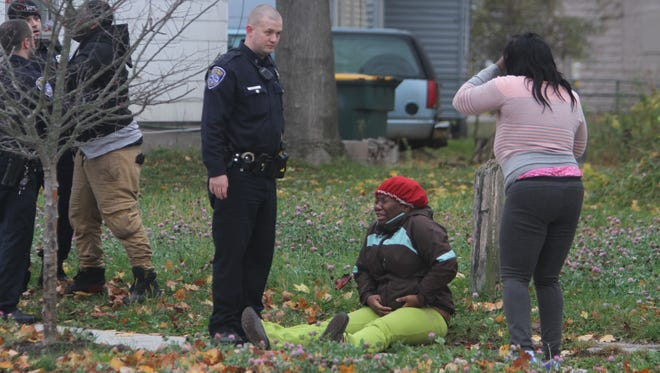 An emotional scene Thursday morning at the scene of a fatal shooting on Seward Street near Jefferson Avenue in Rochester.