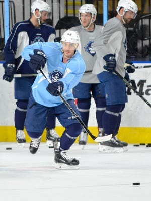 Center Mike Ribeiro, a veteran of more than 1,000 NHL games, passes during practice for the Milwaukee Admirals' AHL playoff opener against the Grand Rapids Griffins.