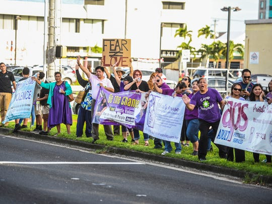 In this Oct. 25, 2017, file photo, the Guam Coalition Against Sexual Assault & Family Violence hold a wave against family violence. There will be an awareness wave for Sexual Assault Awareness Month and Child Abuse Prevention Month from 4:30 to 5:30 p.m. April 4 along Marine Corps Drive in Hagåtña, across Chamorro Village.