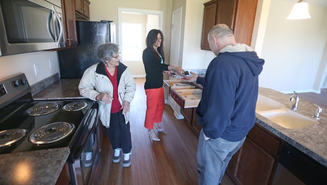 Danielle Gruttadaurio, with Nothnagle Realtors, does a walk through with clients Emilio Raucci, and his mother Angela Raucci, in a home they are purchasing in Greece.