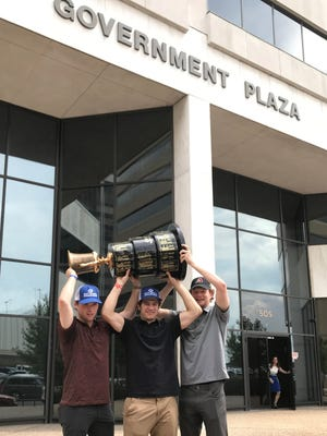 Cameron Cook, Jay Feiwell and Jaxon Castor raised the Robertson Cup on the steps of Shreveport's Government Plaza on Tuesday, dubbed Shreveport Mudbugs Day by mayor Ollie Tyler.