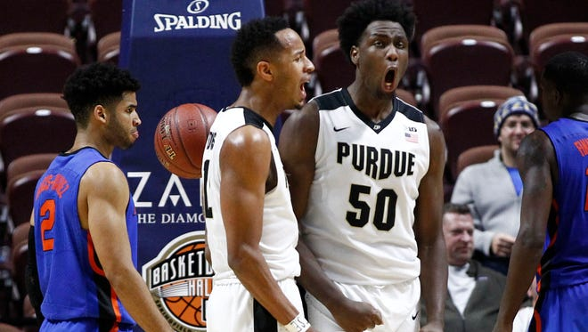 Purdue forwards Vince Edwards (12) and Caleb Swanigan (50) celebrate during the second half of Sunday's 85-70 victory over Florida at Mohegan Sun Arena.