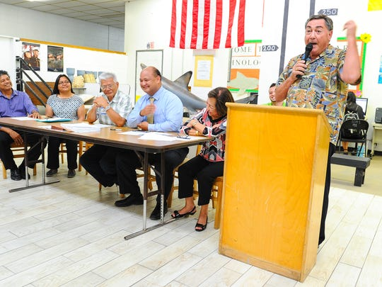 "Local businessman and Guam Education Facilites Foundation representative Phil Flores, right, expresses his excitement on Friday, May 13, after the announcement was made that the non-profit organization had been awarded the task of designing a new high school to replace the aging Simon Sanchez High School in Yigo. ""We're really, really excited! We've been working on this for over a year,"" Flores said."