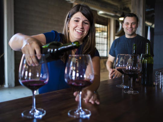 Kate MacDonald, wine maker and owner of The Skeleton Root, pours a glass of Ohio River Valley Red Blend at the urban winery, on McMicken Avenue Thursday, July 14, 2016. The winery will open Saturday, September 10, 2016.