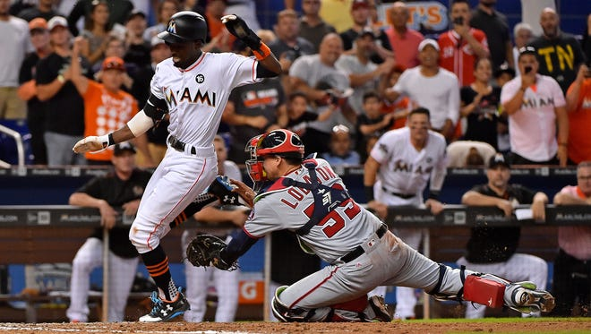 Marlins second baseman Dee Gordon is tagged out at home by Nationals catcher Jose Lobaton in the eighth inning at Marlins Park in Miami.