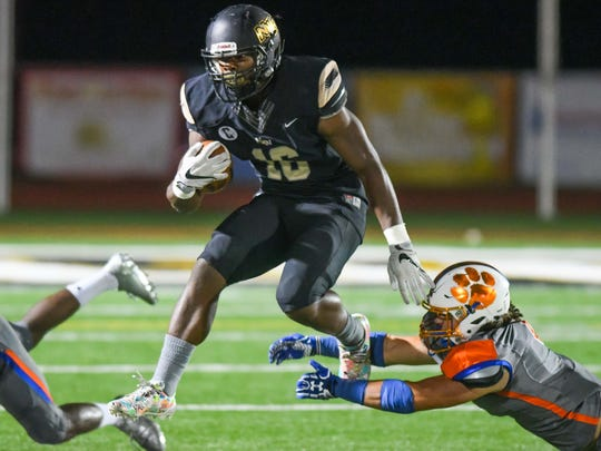 Northwest Rankin running back Cameron Carroll (16) runs the ball against Madison Central during game action Thursday, October 26th, 2017 in Flowood, MS.(Bob Smith-For the Clarion Ledger)